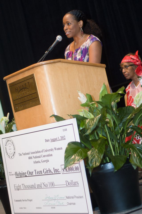 Dr. Carla accepts grant award