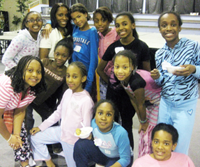 Dr. Carla and pre-teens after a keynote at a girl empowerment event